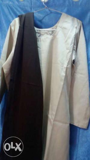 White Silk Top And Black Textile