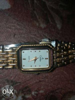A golden watch shows a high standard