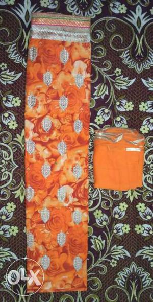 Orange And White Floral Textile