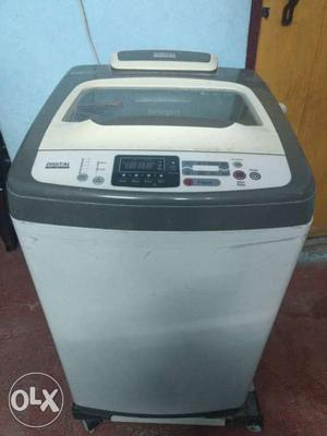 White And Black Top Load Washing Machine