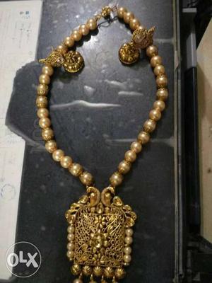 Moti set antic 600,other item price tag