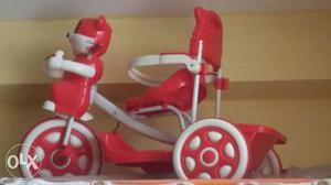 Children's White And Red Plastic Trike