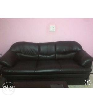 A 3+1+1 black leather sofa is up for sale. It is