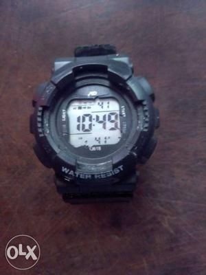 Water resistant stop watch alarm day and date