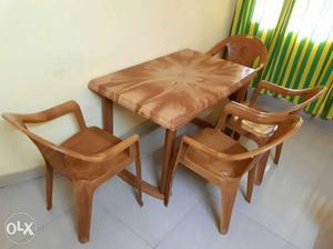 Dining table set with four chairs in