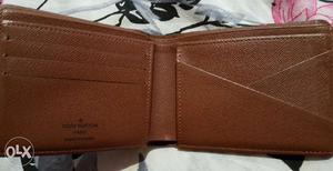 Original LV mens wallet for sale. In Brand New