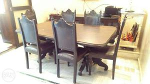 Rectangular Brown Wooden Table With Six Padded Chairs
