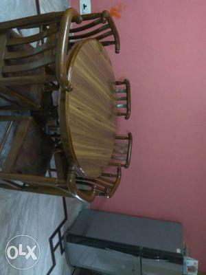 Round Brown Wooden Dining Table With Six Wooden Chairs
