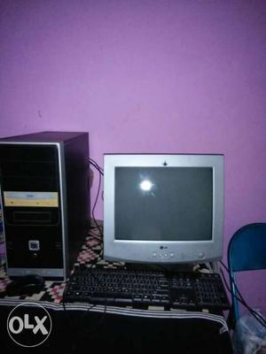 Grey CRT Computer Monitor And Black Computer Tower And