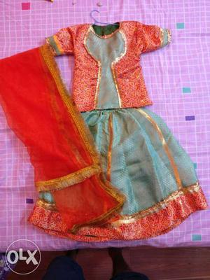 Beautiful and Bright Orange and Green lehanga choli fit for