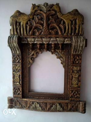 Brown Wooden Animal Embossed Wall Mounted Altar