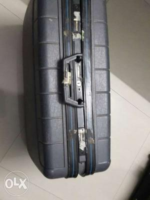 Gray Hard Plastic Suitcase