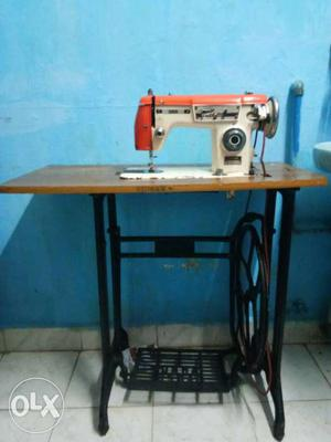 White Treadle Sewing With Brown Wooden Table