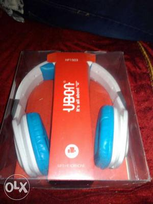 White And Blue Ubon Wireless Headphones In Box