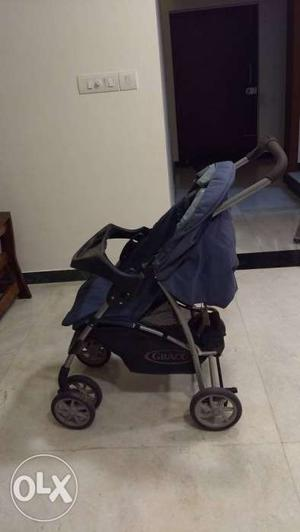 Baby's Purple And Gray Graco Stroller