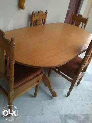 Oblong Brown Wooden Table With Four Brown Wooden Frame Brown