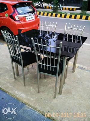 4 sitter dinning table of stainless steel near
