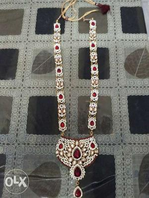 Artificial jewellery for women.Red and golden