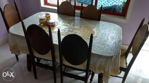 Dining table with chairs and table cloth in good