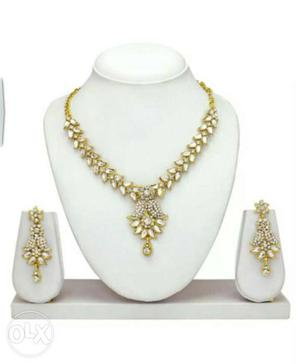 Gold And Diamond Floral Motif Necklace And Earrings
