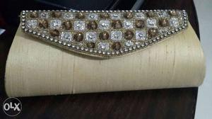 Golden beige clutch purse with small sling. used