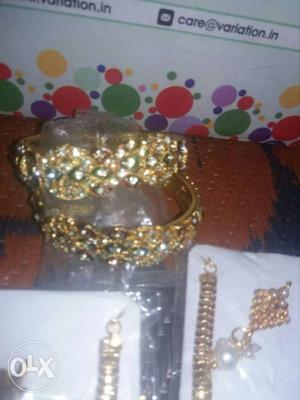 Two Gold And Diamond Rhinestone Bangles