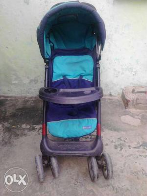 Baby's Black And Teal Convertible Stroller