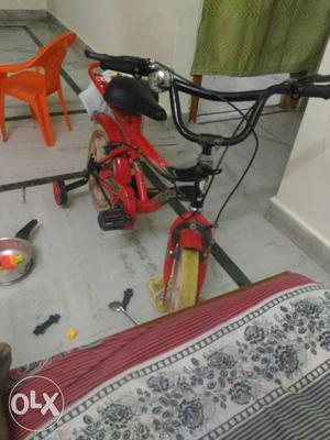 Red And Black Bicycle With Training Wheels