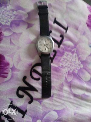 Fastrack Watch with Lether Streps and Crome Dial.