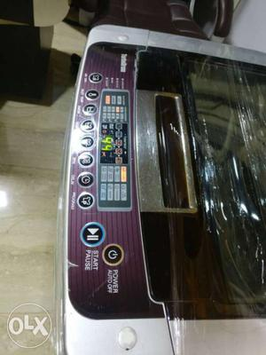 Silver and Maroon top load LG washing machine with delivery