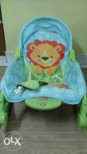 Blue And Green Fisher Price Lion Print Bouncer