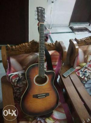 Brown Acoustic Guitar with Digital Tuner and Bag