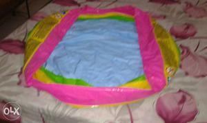 Pink And Yellow Inflatable Pool