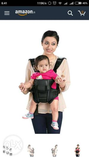 Red colour baby carrier similar to photo. branded