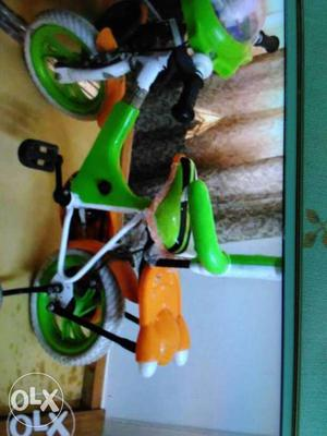 Toddler's White And Green Bicycle With Training Wheels