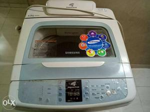 Gray And White Samsung Top Load Washing Machine