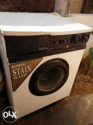 White And Black Front Load Washing Machine