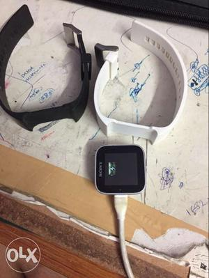 White Sony Smart Watch With Black And White Sport Bands