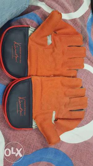Wicket keeping gloves with under covering gloves