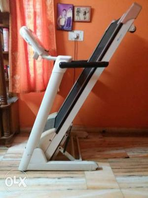 White And Black Treadmill with black gym cycle