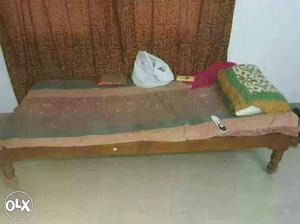 Single cot bed, 3 by 6 and made of teak wood. In