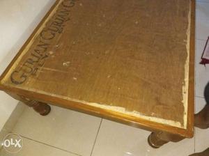Single wooden bed six feet by 3 feet