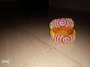 Two Brown And Pink Rings