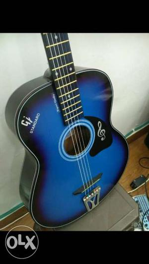 Blue and black colour acoustic guitar, this