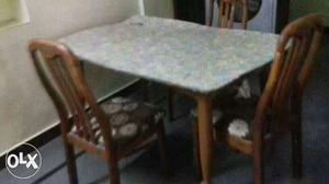 Dinning table good condition 3chairs good and one damage