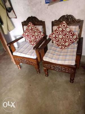 Two Brown Wooden Framed White Cushioned Armchairs