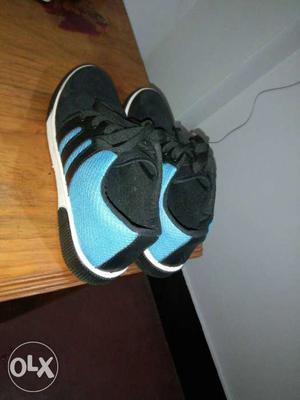 Pair Of Black And Teal Adidas Sneakers