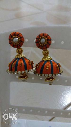 Pair Of Black-and-orange Silk Thread Jhumka Earrings