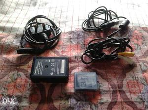 Black And White AC Adapter With Cable. Panasonics cemers'