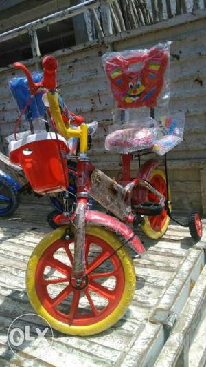 Children's Red And Yellow Bicycle With Training Wheels